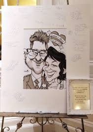 wedding signing board edd travers on a recent wedding caricature guest