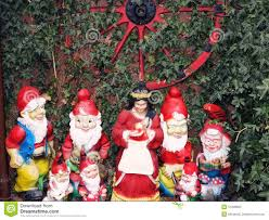 snow white and the seven dwarfs in a garden of the tale town