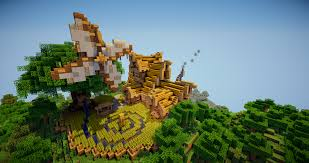 fantasy farmhouse with a windmill tree creative mode