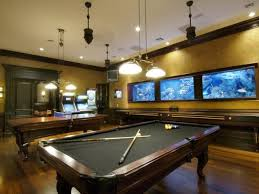 sleek video game room design idea in basement interior with bar