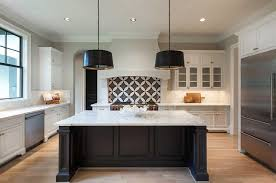 white kitchen black island black and white kitchen with arteriors iron pendants