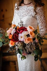 theme wedding bouquets marsala pantone color maine rustic wedding venue