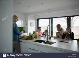 family eating at kitchen island stock photo royalty free image