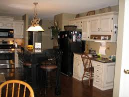 Kitchen Garage Door by Kitchen White Galley Kitchen With Black Appliances Wallpaper