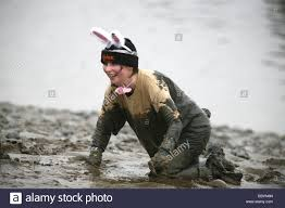 a contestant in fancy dress crawls towards the finish of the mad