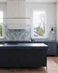 black cabinets marble backsplash floating shelf kitchen design