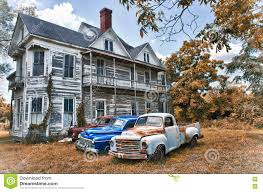 One Story Farmhouse by Abandoned Two Story Farmhouse With Three Vintage Automobiles Stock