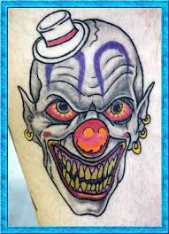 true animated evil clown face with hat tattoo design for men