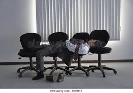 Sleeping Chairs Japanese Businessman Sleeping On Chairs Stock Photos U0026 Japanese