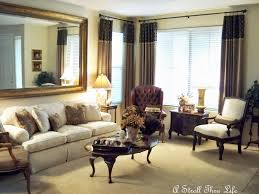 photos hgtv gray living room with large mirror loversiq a stroll thru life beige cream living room on budget the huge mirror over sofa was dining