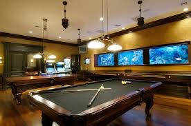 Table For Under Wall Mounted Tv by Classic Pool Table Under Ceiling Hanging Lights And Wall Mount Tv
