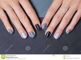 female hands with a stylish neutral manicure stock photo image