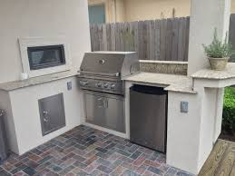 Brinkmann Backyard Kitchen by Custom Stucco Outdoor Kitchen With A Small Raised Counter For Bar