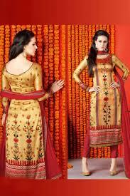 golden orange color pleasing satin printed party wear salwar suit in golden color from