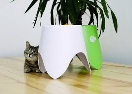 Small Self Watering Pots The Self Watering Tripot Lets Plants Take Care Of Themselves
