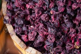 dried hibiscus flowers dried hibiscus flowers in a wooden stock photo picture and