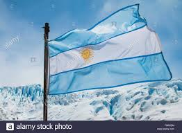 Argentine Flag Argentine Flag Flying In Front Of The Perito Moreno Glacier In