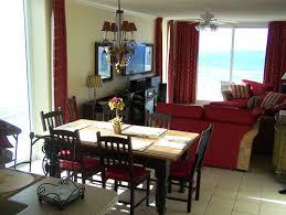 interior open floor plan kitchen dining living room red sofa sets