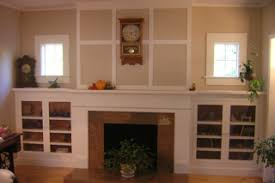 classic craftsman fireplace mantel with side cabinets