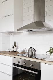 kitchen design ideas 9 backsplash ideas for a white kitchen if you want to keep the all white look going but want just a bit of texture white subway tiles with a light grout could be a way to achieve the kitchen