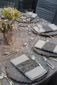 silver wedding plates sequined napkin holders match the glamorous silver tablecloth and