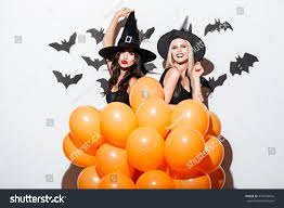 two cheerful young women witch halloween stock photo 479696026
