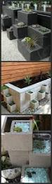 he made this ugly cinderblock wall beautiful with more