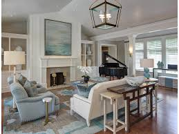 arched windows upholstered furniture rustic wood beams chandelier