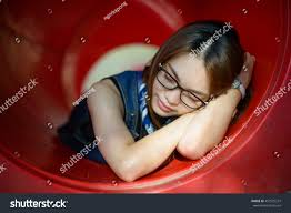 sleeping on short hair portrait asian girl short hair sleeping stock photo 451555237