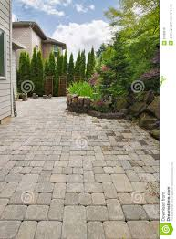 backyard brick paver patio with pond royalty free stock image