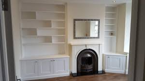 traditional fitted cupboards and shelves in alcoves