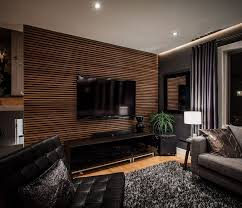 living room accent wall with brown furniture laminate wood