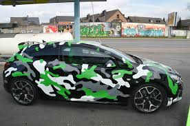 camo wrapped cars opel astra opc in camo wrap looks tough autoevolution