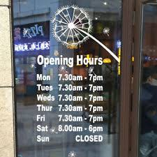 open closed business hours message sign with vinyl letters window