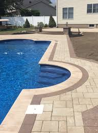 Pool Patios by We Used Unilock Treo Pavers In Tuscany For The Patio And Pool