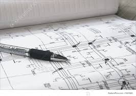 picture of pen and architectural plans close up