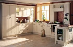 cream wooden kitchen cabinets brown wall white ceiling country