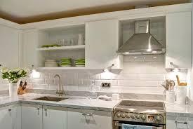kitchen with white marble beveled subway tile backsplash