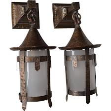 pair of arts and crafts sconces with glass cylinder shades from