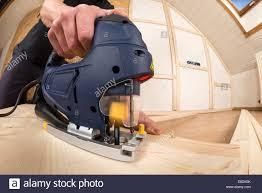 Cutting Laminate Flooring Jigsaw Jigsaw At Work Cutting Plywood Stock Photo Royalty Free Image