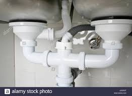 Drain Pipes Under A Kitchen Sink With Dishwasher Connection Stock - Drain kitchen sink