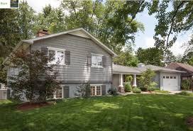 split level house with front porch split level renovation remodel curb appeal front porch paint colors
