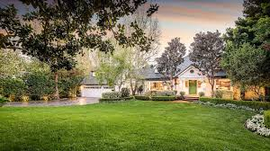 actor peter gallagher cuts price on his beautiful brentwood home