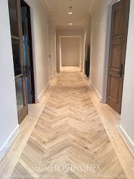 wood tile in a herringbone pattern such a great look and so