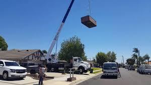 using a crane to install a catalina swim spa extreme backyard