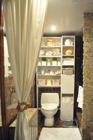 idea for small bathroom high diy wooden cabinet painted with white color toilet for