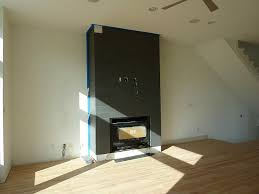 Tiled Fireplace Wall by Awesome Brown Porcelain Tile Fireplace In The High Gloss Floor