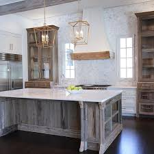 distressed white kitchen island into this beautifully rustic cottage kitchen featuring a