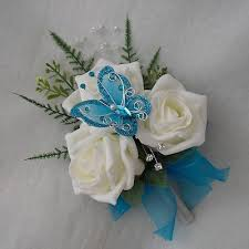 turquoise corsage ivory roses get a whimsical touch thanks to an enchanting