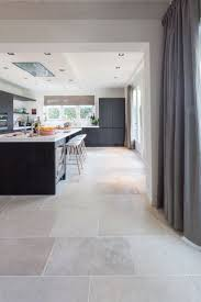 backsplash kitchen with travertine floors cherry cabinets